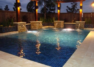 wonderful-swimming-pool-with-travertine-pavers-and-water-feautures