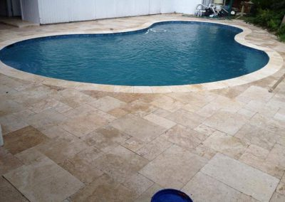 noce travertine unfilled and tumbled french pattern pool coping and pool pavers