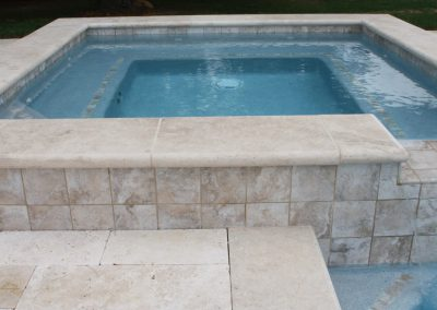 Ivory pool coping and matching pool pavers