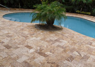 Noce travertine outdoor tiles in herringbone pattern