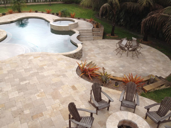 Noce travertine tiles unfilled and tumbled french pattern