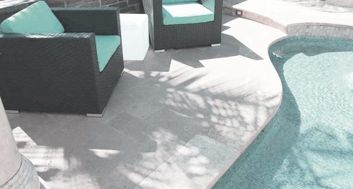 shell white limestone french pattern tiles coping around pool