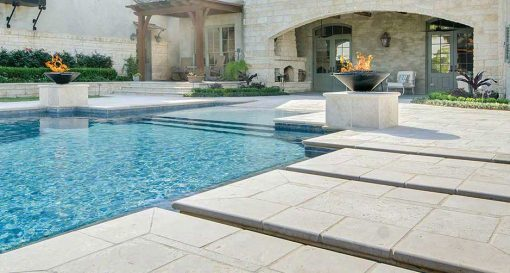 shell white limestone pavers an coping tiles around pool
