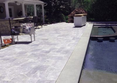 Pearl Grey Travertine Tiles from Silvas Turkey with Harkaway Bluestone pool coping