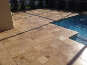 noce unfilled and tumbled travertine pavers and pool coping