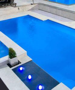 capri white travertine tiles around pool pavers and coping