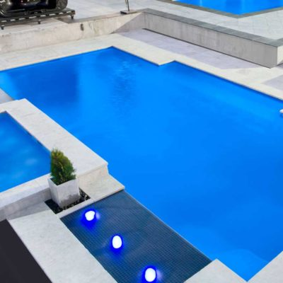 capri white travertine tiles around pool pavers and coping