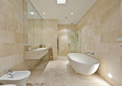 Ivory travertine honed and filled bathroom tiles
