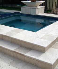 ivory travertine pool coping tiles around pool