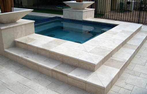 ivory travertine pool coping tiles around pool