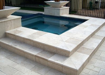 ivory travertine unfilled and tumbled french pattern pool pavers and coping tiles