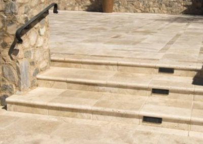 Ivory travertine tiles, pavers and matching pool coping