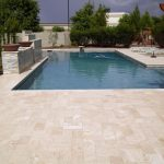 ivory unfilled and tumbled travertine pool pavers and coping tiles