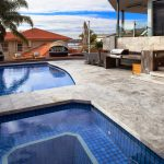 silver unfilled and tumbled travertine pool coping and paving