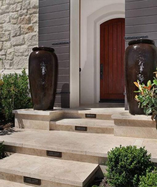 Cream Travertine tiles used on steps.