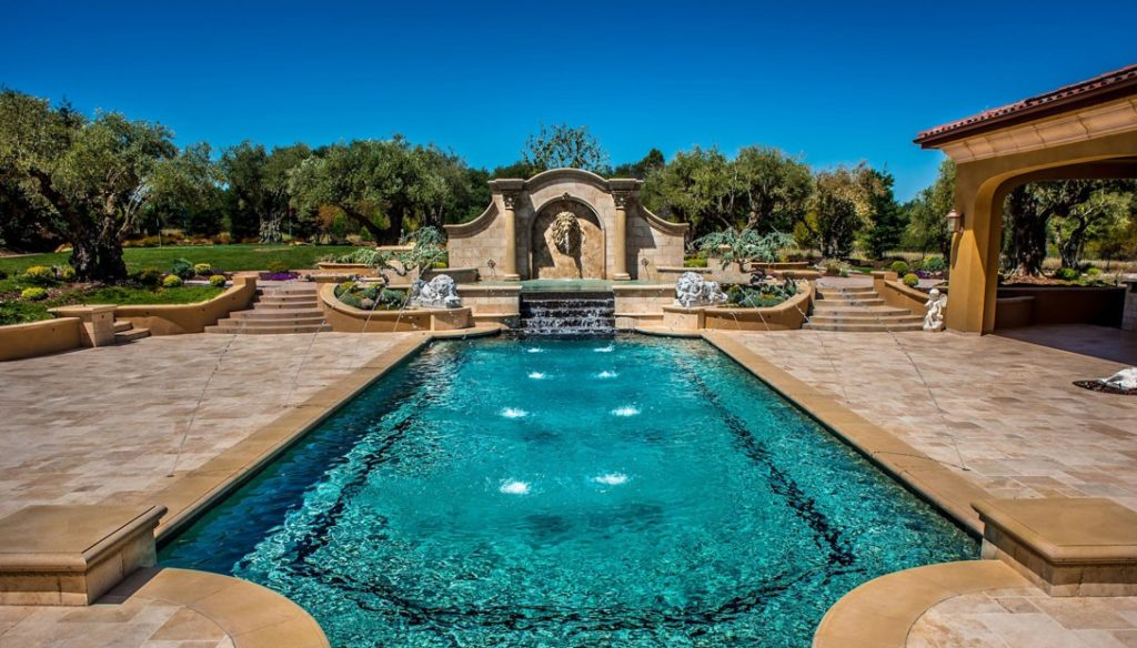 noce french pattern travertine unfilled and tumbled pavers around pool