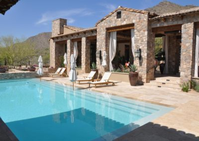 travertine-pool-deck-Patio-Mediterranean-with-chaise-lounge-container-plants