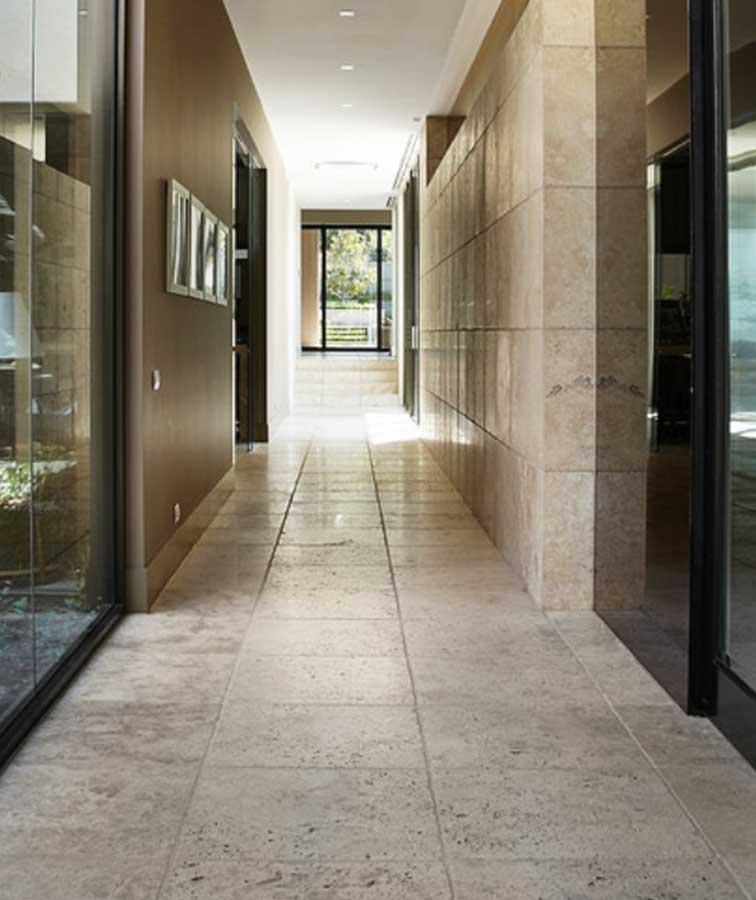 Travertine indoor tiles in a hallway in Melbourne.