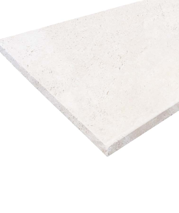 White travertine pool coping in tumbled