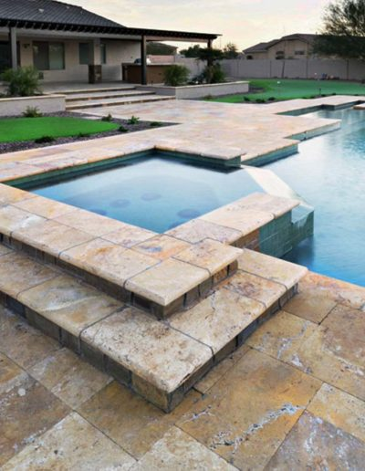 Travertine pool coping in a Melbourne swimming pool.