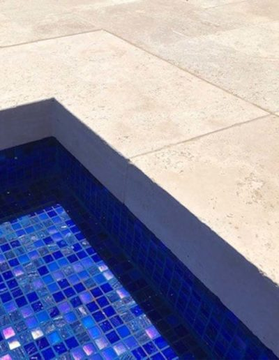 Drop face pool coping in Melbourne made from travertine.