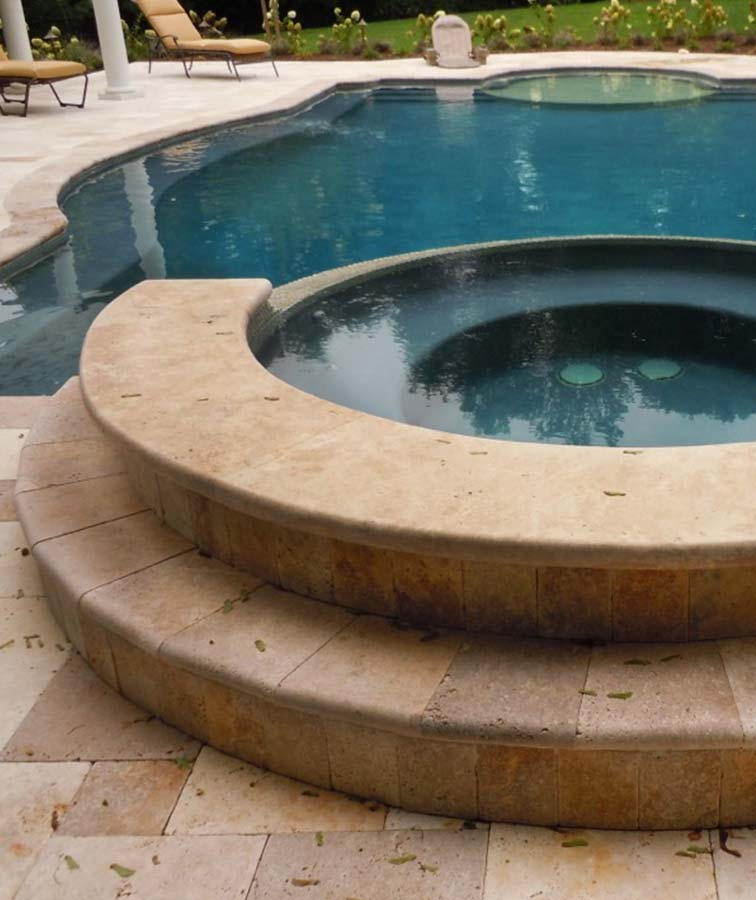 Noce travertine pool coping with a bullnose edge.