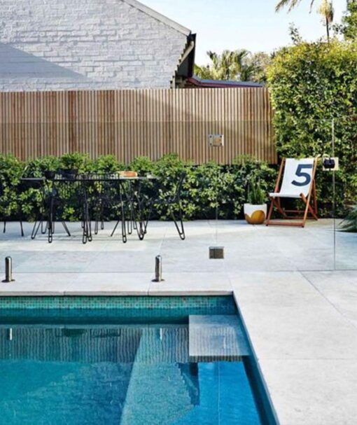 Melbourne Capri limestone pool coping with a tumbled edge