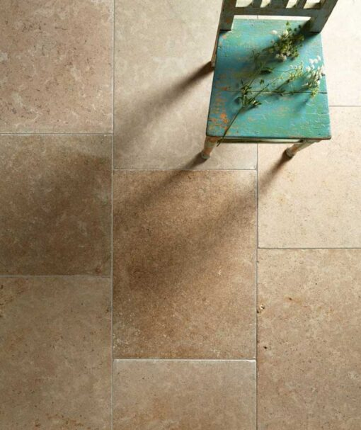 Noce Travertine tiles with a green chair.
