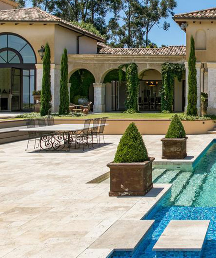 Travertine pavers around a pool and outdoor area.