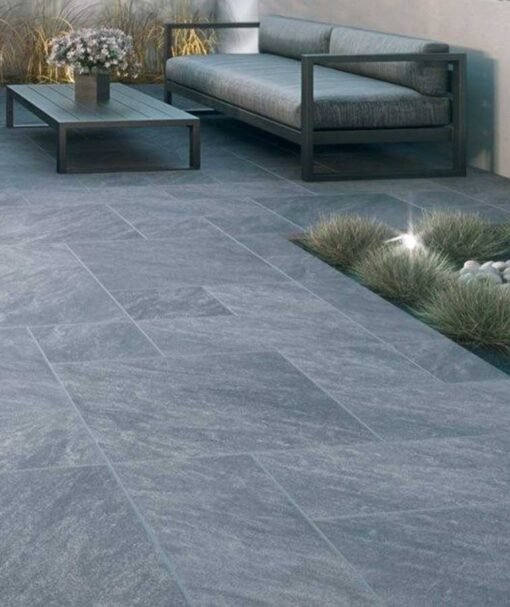 Grey french pattern pavers laid in an outdoor area.