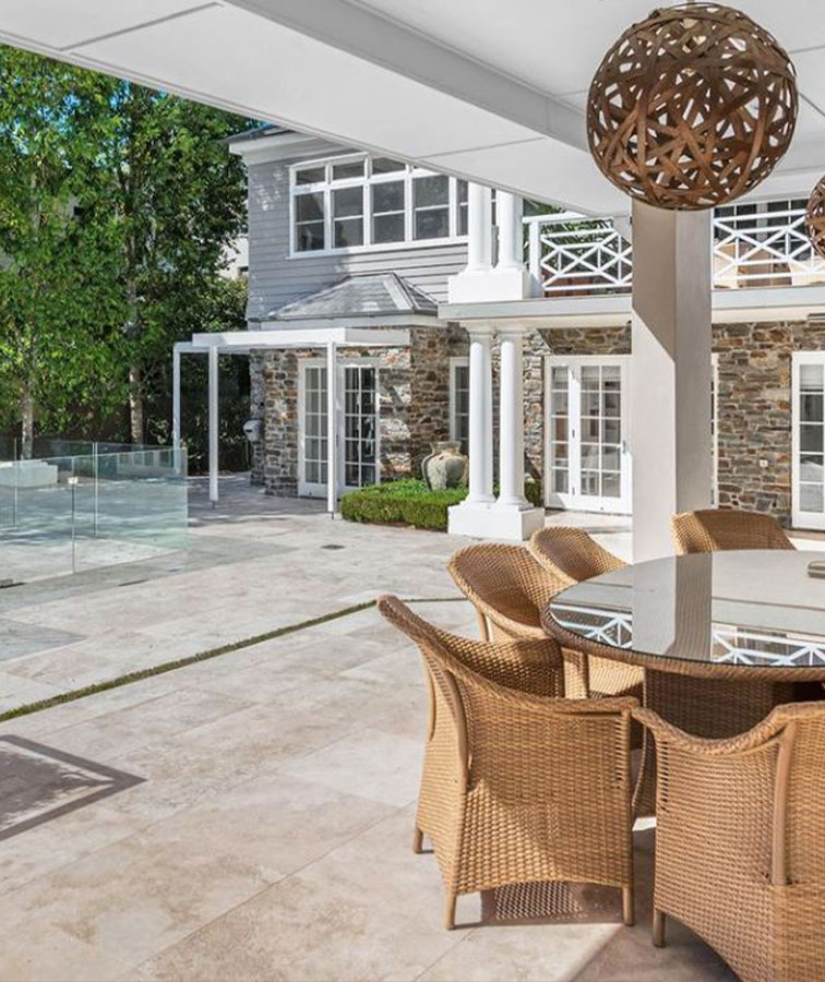 Outdoor travertine tiles and outdoor dining set.