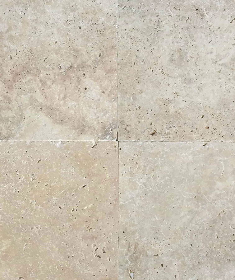 An up close shot of a travertine tile with natural holes.