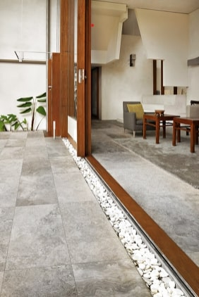Silver travertine pavers laid in an outdoor/indoor setting.