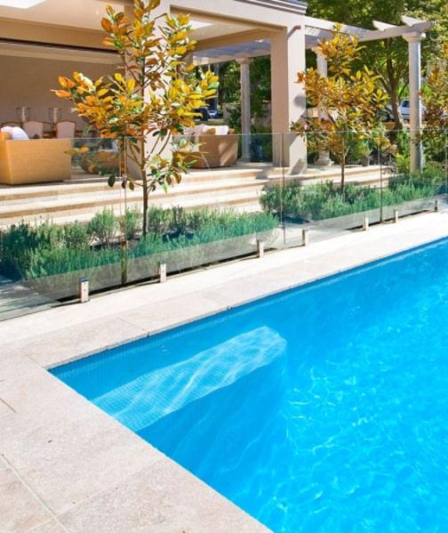 Travertine square edge pool coping tiles.