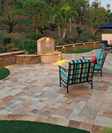 Travertine tiles laid in an outdoor seating area.